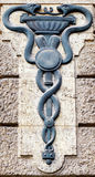 Aesculapian staff - Caduceus. Old Aesculapian staff - Caduceus at a historic building stock photography