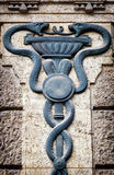 Aesculapian staff - Caduceus. Old Aesculapian staff - Caduceus at a historic building stock image