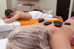 Aesthetic massage for two with stone therapy Royalty Free Stock Photos