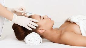 Aesthetic Surgery. Woman Having Injection In Forehead. At Beauty Salon, Side View stock image