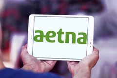 Aetna health care company logo. Logo of Aetna health care company on samsung tablet. Aetna is an American managed health care company, which sells traditional Stock Photos