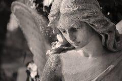af的美好的关闭与甜点的一个面孔天使大理石雕塑 图库摄影