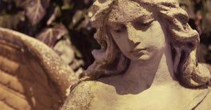af的美好的关闭与甜点的一个面孔天使石头雕塑 库存图片