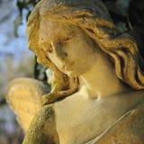 af的美好的关闭与甜点的一个面孔天使石头雕塑 免版税图库摄影
