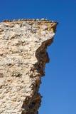 Afbrokkelende rotsmuur in spookstad (Kayakoy), Turkije Stock Foto