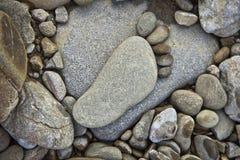 Afdruk van een menselijke voet van stenen Stock Foto's