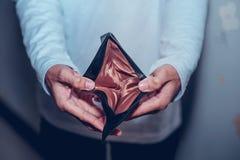 Affär för hand- och plånbokpengardanande arkivbild