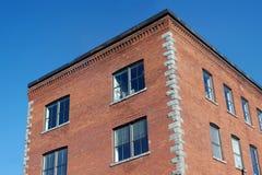 Affär för kontor för arkitektur för hörn för byggnad för röd tegelsten gammal Royaltyfria Bilder
