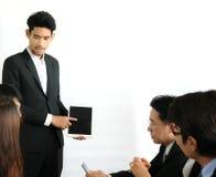 Affär som arbetar i ett möte Royaltyfri Fotografi