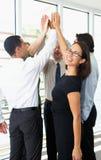 Affär Team Giving One Another High fem Arkivfoton