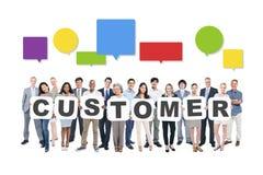 Affär Team Holding Word Customer Arkivfoto