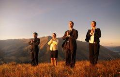 Affär Team Meditating Mountains Concept Fotografering för Bildbyråer