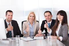 Affär Team Showing Thumb Up Sign Arkivfoton
