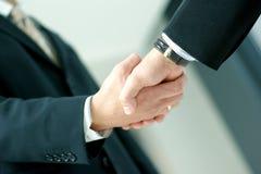 affären hands folk som tillsammans upprör arkivbild