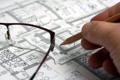 affären tecknar plan s för handmanblyertspennan royaltyfri bild