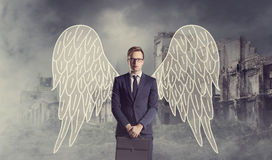 Affärsängel som står över apokalyptisk bakgrund Kris def Fotografering för Bildbyråer