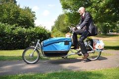 affärsbarncreche hans män som rider till Royaltyfri Fotografi