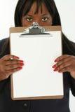 affärsclipboardkvinna arkivbild