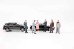 Affärsdiagram och leksakbil Arkivbild
