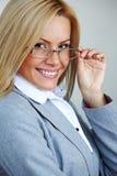 affärsexponeringsglaskvinna Arkivfoto
