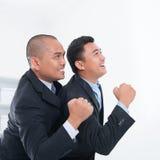 Affärsfolk som firar framgång Arkivbild