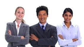 Affärsfolk som går och poserar Arkivbild