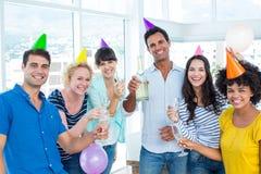 Affärsfolk som rostar med exponeringsglas av champagne Fotografering för Bildbyråer