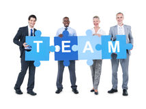 Affärsfolk som rymmer Team Sign Arkivfoton