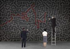 Affärsfolk som ser labyrint Fotografering för Bildbyråer