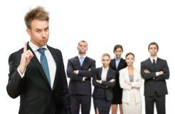 Affärsfolk som tystas med bandet över deras mun Arkivfoto