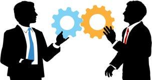 Affärsfolket sammanfogar techsamarbetslösningen Arkivbild