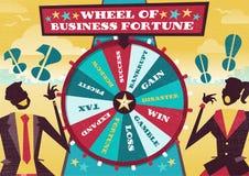 Affärsfolket spelar affärshjulet av förmögenhet Arkivfoto