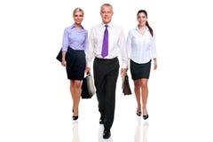 affärsfolket team tre som går arkivbilder