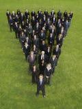 Affärsgrupp i triangelbildande Royaltyfri Bild