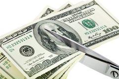 Affärsidé. Dollar är bits med sax. Royaltyfri Bild