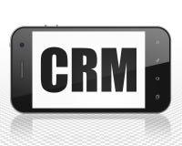 Affärsidé: Smartphone med CRM på skärm Royaltyfri Foto