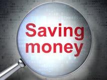 Affärsidé: Sparande pengar med optiskt exponeringsglas Arkivbild