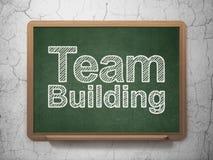 Affärsidé: Team Building på svart tavlabakgrund Royaltyfria Bilder