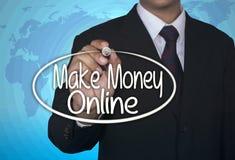 Affärsidéhandskriftmarkören och skriver gör pengar online- Fotografering för Bildbyråer