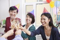 Affärskollegor som rostar med Champagne Royaltyfri Fotografi