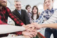 Affärskollegor som staplar händer Royaltyfria Bilder