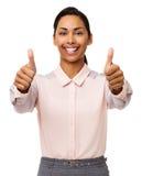Affärskvinna Gesturing Thumbs Up mot vit bakgrund Arkivfoto