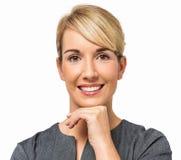 Affärskvinna With Hand On Chin Smiling Fotografering för Bildbyråer