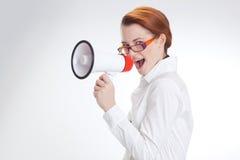 Affärskvinna i regeringsställning med megafon Fotografering för Bildbyråer