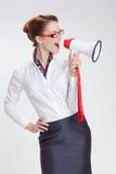 Affärskvinna i regeringsställning med megafon Royaltyfri Foto