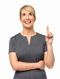 Affärskvinna With An Idea som pekar upp Arkivfoto