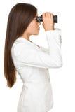 Affärskvinna Looking Through Binoculars Royaltyfri Fotografi