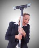 Affärskvinna med dammsugare på vit Royaltyfri Fotografi