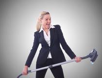 Affärskvinna med dammsugare på vit Royaltyfria Foton