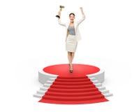 Affärskvinna med den guld- koppen på röd matta, Royaltyfria Foton